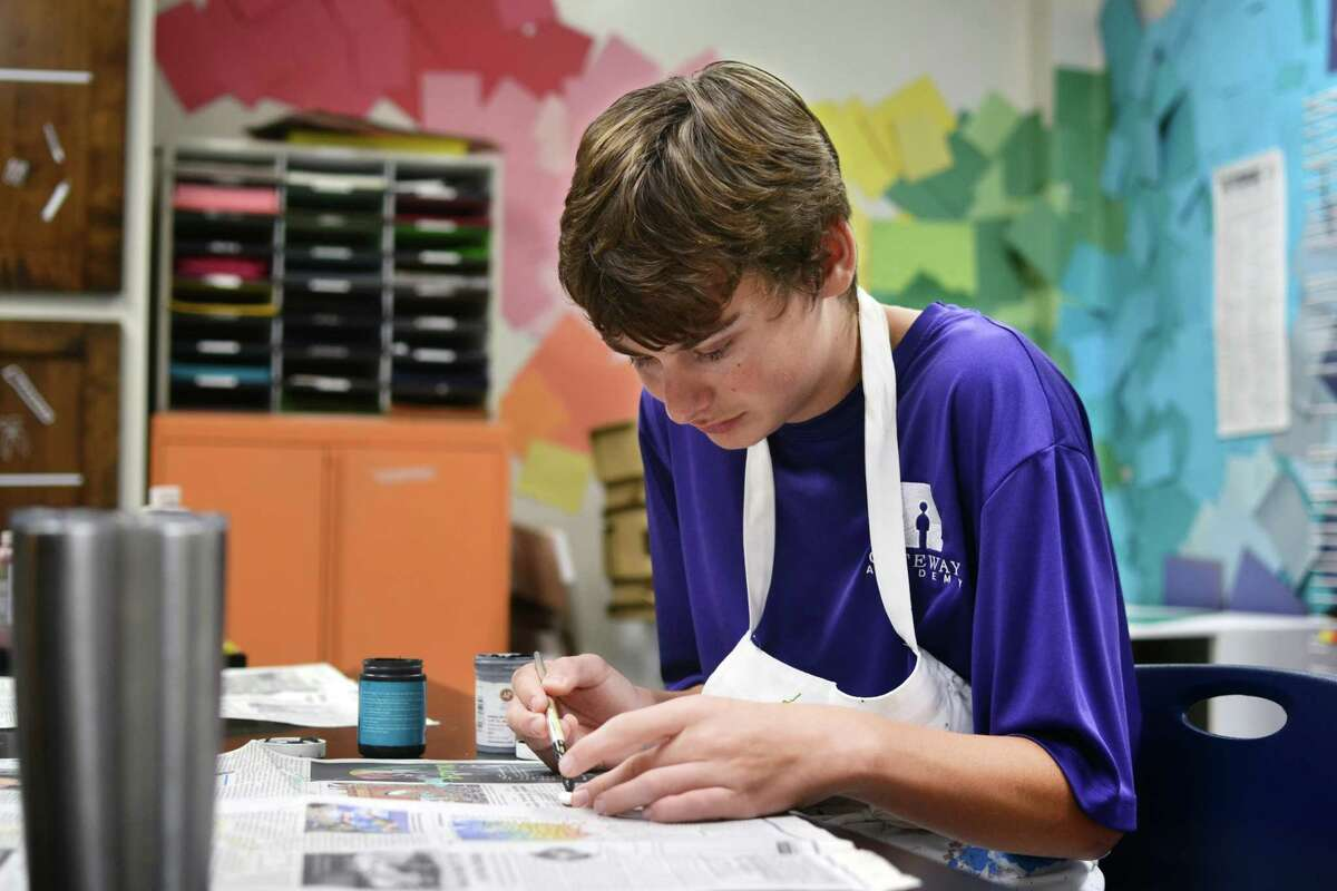 At Gateway Academy, middle and high school students with learning and social differences participate in activities like art, theater and exercise with the goal of their becoming independent, contributing members of society. Here, a student works on an art assignment.