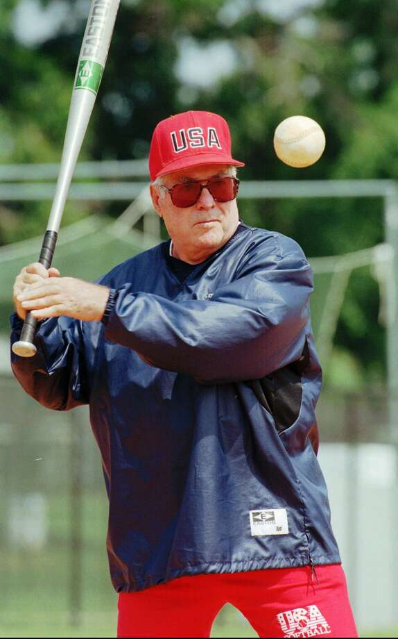 USA Olympic women's softball team head coach Ralph Raymond hits to the team during practice at the South Commons softball complex in Columbus, Ga., June 4, 1996. As coach of the USA women's national teams, Raymond has won five gold medals in international Softball Federation play, including three consecutive titles, 1986, 1990, 1994, with a combined record of 72-1. Photo: RIC FELD / Associated Press / AP