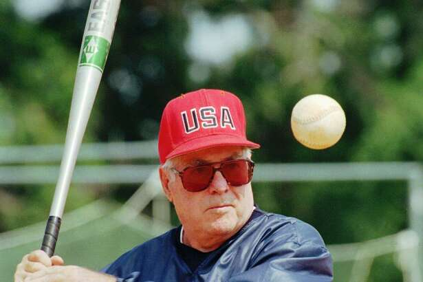 USA Olympic women's softball team head coach Ralph Raymond hits to the team during practice at the South Commons softball complex in Columbus, Ga., June 4, 1996. As coach of the USA women's national teams, Raymond has won five gold medals in international Softball Federation play, including three consecutive titles, 1986, 1990, 1994, with a combined record of 72-1.