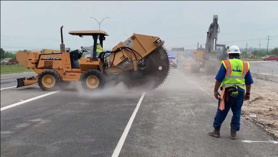 File photo of work being done after a large sinkhole shut down the main lanes of westbound U.S. 90 on Tuesday, April 23, 2019. Photo: SAWS