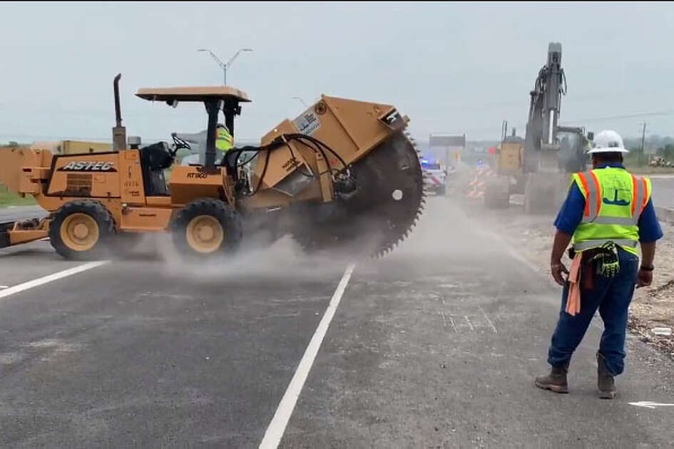 A large sinkhole shut down the main lanes of westbound Highway 90 on Tuesday, April 23, 2019. Repairs began around noon on the collapsed sewer line.