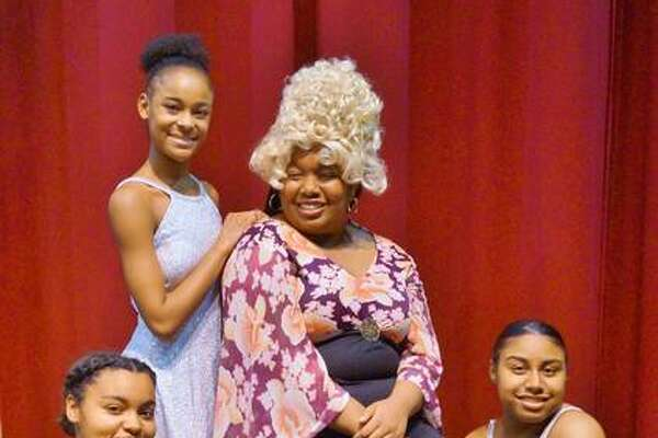 "Dynamites, played by Andrea Richards, Ty'ria Rounds and E'Niya Field, and Morgan Palmer, center, as Motormouth Maybelle in Alton High School's upcoming production of ""Hairspray,"" running May 2 through 5."