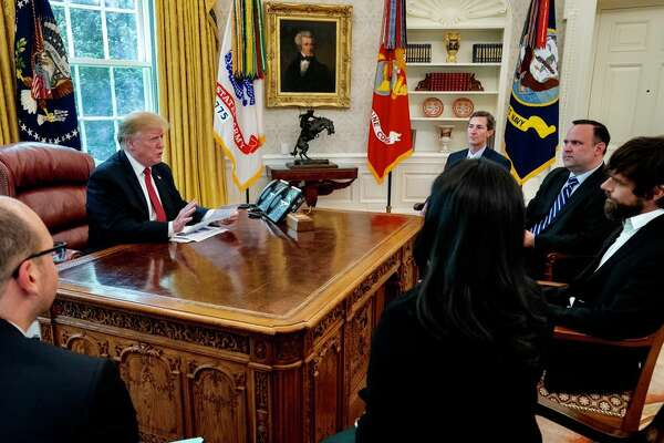 President Donald Trump meets with Twitter CEO Jack Dorsey, right, in the Oval Office at the White House on Tuesday, April 23, 2019.