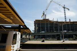 An apartment building is seen under construction from the MacArthur BART station in Oakland, California, on Tuesday, April 23, 2019.
