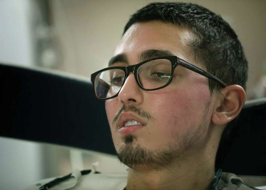 Dez Del Barba, 21, is hospitalized at the Army Institute of Surgical Research Burn Center in San Antonio for necrotizing fasciitis, a rare and aggressive bacterial infection. Photo: Bob Owen / ©2019 San Antonio Express-News