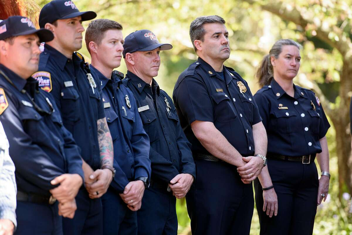 Members of Cal Fire listen during a press conference held in Tilden Park in Berkeley, Calif, on Tuesday, April 23, 2019. Governor Gavin Newsom joins Oakland Mayor Libby Schaaf and Berkeley Mayor Jesse Arregu'n as well as state and local fire officials with Cal Fire to discuss the hazards posed by wildfires at the interface where wild land and urban development meet.