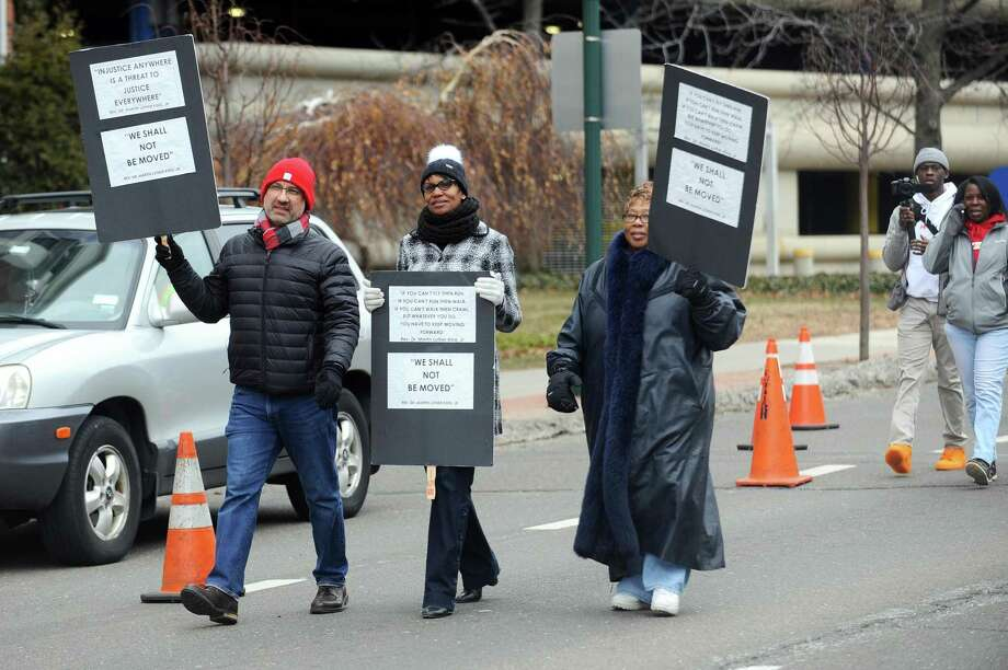 Stamford Assistant Superintendent Dr. Tamu Lucero, center, walks in the annual Martin Luther King Jr. Day march in Stamford, Conn. on Monday, Jan. 15, 2018. The school board is expected to vote Tuesday night to name Lucero as the new leader of the school district. Photo: Michael Cummo / Hearst Connecticut Media / Stamford Advocate