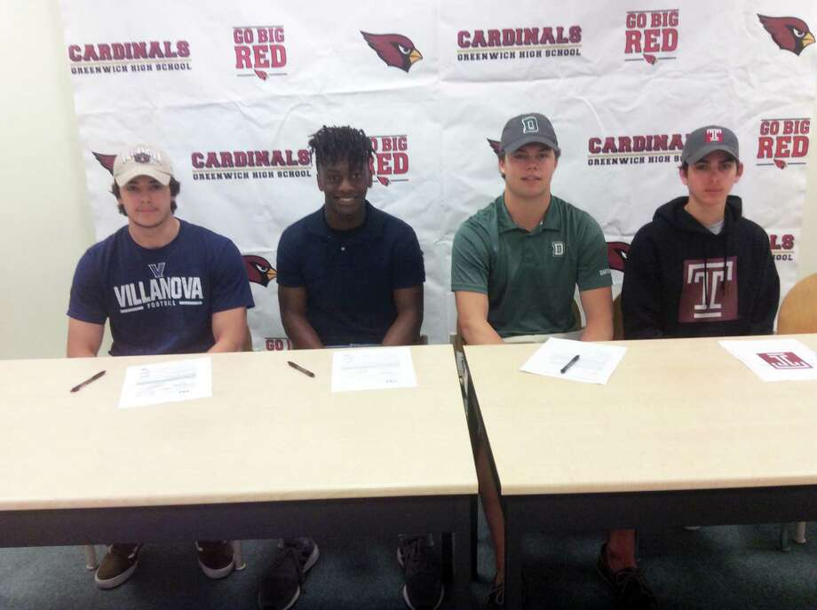 From left to right, Greenwich High School seniors Hunter Cusimano, Ryan Raybuck, Gavin Muir and Summit Gillespie will each take their athletic talents to the collegiate level. Cusimano (Villanova University), Raybuck (St. Anselm College) and Muir (Dartmouth College) will each play football at the collegiate level. Gillespie will row at Temple University. Greenwich High school held a ceremony on Tuesday recognizing the four student athletes.. Photo: David Fierro / Hearst Connecticut Media / Connecticut Post