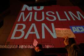 A projection against the Muslim Ban appears on the wall during a protest in front of the San Francisco Federal Building where Resist SF projected several messages against the Trump administration's travel ban, in San Francisco, Calif., on Tuesday, June 26, 2018.