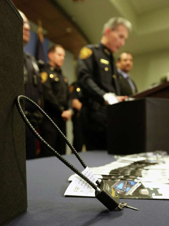 A gun lock is seen in the foreground as San Antonio police Chief William McManus speaks Tuesday, April 23, 2019 at a press conference in the public safety headquarters about free locks the police department will be giving away through its SAFFE offices. Photo: William Luther, Staff / Staff Photographer / ©2019 San Antonio Express-News