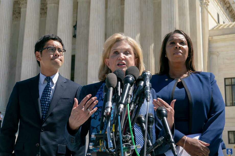 Rep. Carolyn Maloney, D-N.Y., center, joined from left by Dale Ho, attorney for the American Civil Liberties Union, and New York State Attorney General Letitia James, speaks to reporters after the Supreme Court heard arguments over the Trump administration's plan to ask about citizenship on the 2020 census, in Washington, Tuesday, April 23, 2019. Critics say adding the question would discourage many immigrants from being counted, leading to an inaccurate count. Photo: J. Scott Applewhite, AP / Copyright 2019 The Associated Press. All rights reserved.
