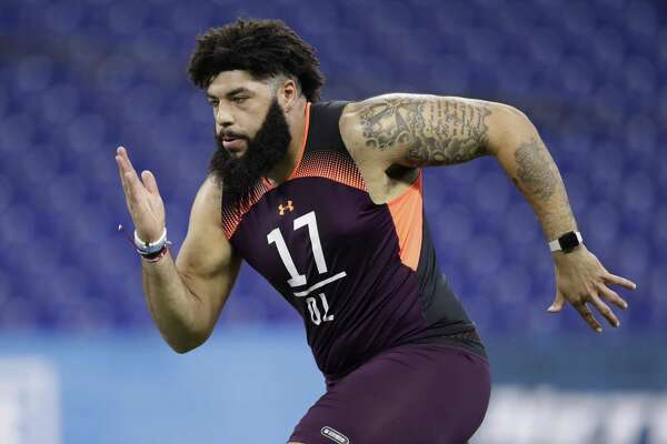 FILE - In this March 1, 2019, file photo, Oklahoma offensive lineman Cody Ford runs a drill at the NFL football scouting combine in Indianapolis. Ford is a possible pick in the 2019 NFL Draft.(AP Photo/Michael Conroy, File)
