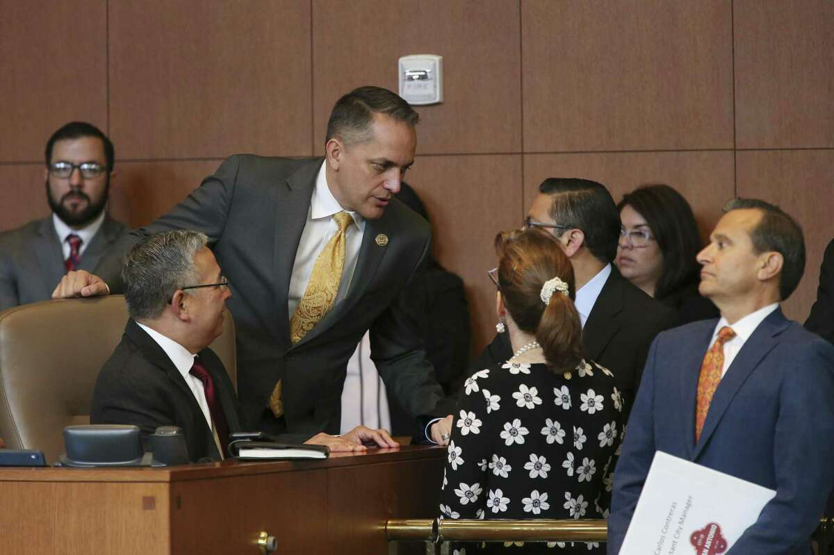 San Antonio City Councilman Greg Brockhouse, center left, talks with city staff as the council discussed his proposal during a regular council meeting, Thursday, April 18, 2019. Brockhouse proposed revisiting a contract that excluded Chick-fil-A restaurant from operating at the San Antonio International Airport. The council voted against the move.