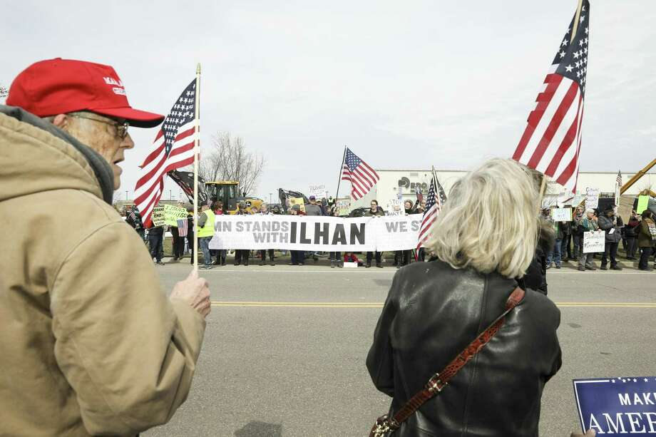 Supporters of President Donald Trump rally on one side of the street as supporters of Rep. Ilhan Omar (D-Minn.) rally on the other, in Burnsville, Minn., April 15. A reader comments on the important error Rep. Omar made during her speech March 23. Photo: TIM GRUBER /NYT / NYTNS