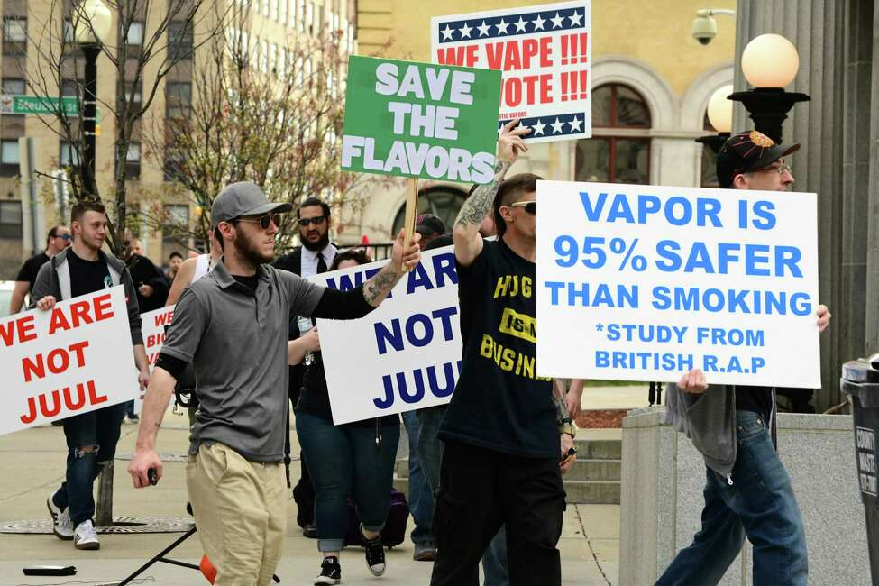 Vaping advocates and consumers march around the Albany County Courthouse as a part of a rally to oppose a ban on flavored tobacco products on Tuesday, April 23, 2019 in Albany, N.Y. (Lori Van Buren/Times Union)