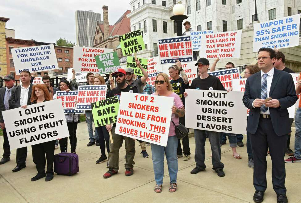 Vaping advocates and consumers rally outside Albany County Courthouse to oppose ban on flavored tobacco products on Tuesday, April 23, 2019 in Albany, N.Y. (Lori Van Buren/Times Union)