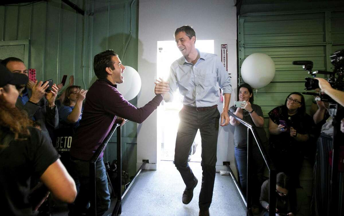Democratic presidential candidate Beto O'Rourke greets audience members at Pimenta, Wednesday, April 17, 2019, in Fredericksburg, Va. (Mike Morones/The Free Lance-Star via AP)