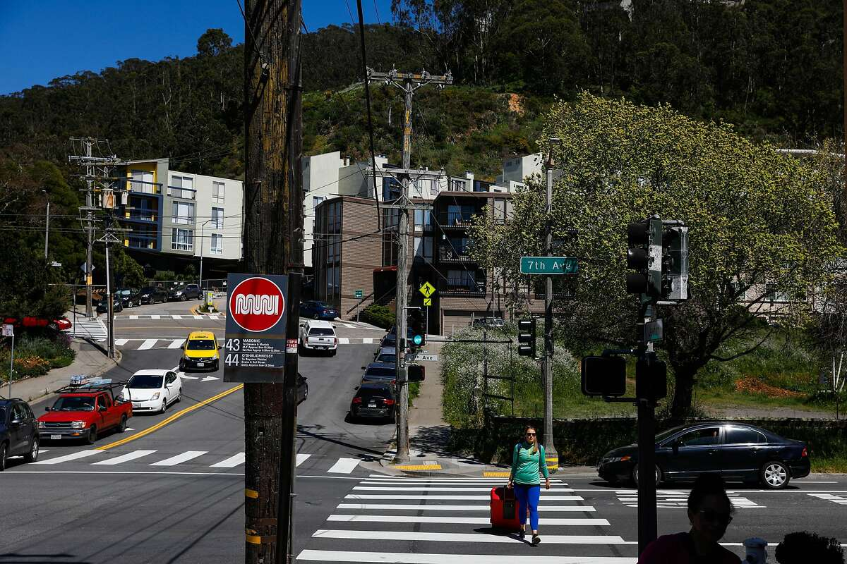 A woman crosses Warren Drive and 7th Street in San Francisco, California, on Tuesday, April 23, 2019.