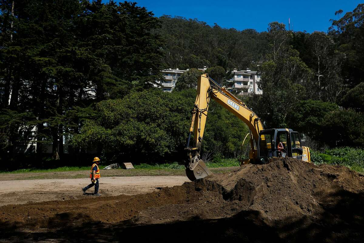 An undeveloped plot of land has dirt removed from the property at Warren Drive and 7th Street in San Francisco, California, on Tuesday, April 23, 2019.