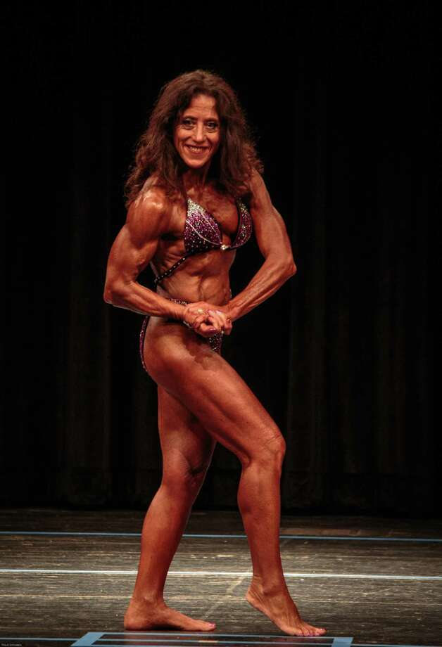 Theresa Schweers of Wallingford strikes a pose during the 2019 NPC Powerhouse Classic at East Haven High School on April 13. The 60-year-old mother of two took second in one competition class and third in another Photo: Contributed Photo / Floyd Schweers