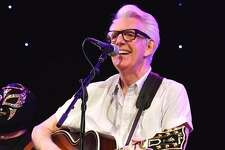 "Singer, songwriter, guitarist and producer Nick Lowe is shown performing at the start of his concert at Infinity Hall in Hartford, April 14, 2019. His highly entertaining and passionate performance to a capacity crowd included the Los Straightjackets as his backing band. His set included a interesting mix of songs from his long and successful music career. Nick is best known for his hits ""Cruel to Be Kind"" and ""I Love the Sound of Breaking Glass,"" as well as his production work with Elvis Costello, Graham Parker, and others. To learn more about musician Nick Lowe, visit www.nicklowe.com"