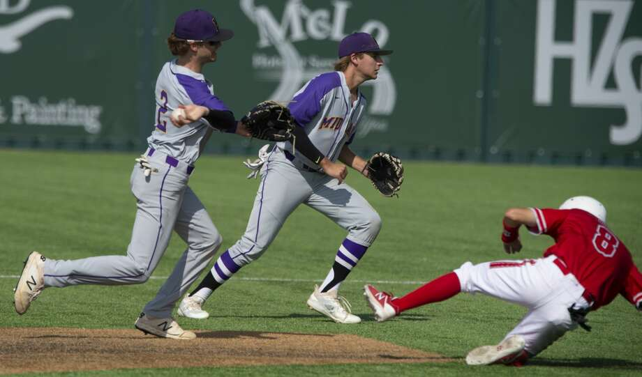 Midland High's Tyler Wade throws to first to complete the double play after getting the out at second on Odessa High's Zach Attaway 04/23/19 at J.E. Pressly Field. Tim Fischer/Reporter-Telegram Photo: Tim Fischer/Midland Reporter-Telegram