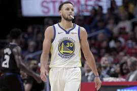 Stephen Curry (30) walks back up court after the Clippers called a timeout in the second half as the Golden State Warriors played the Los Angeles Clippers in Game 4 of the First Round of the NBA Playoffs at Staples Center in Los Angeles, Calif., on Sunday, April 21, 2019.
