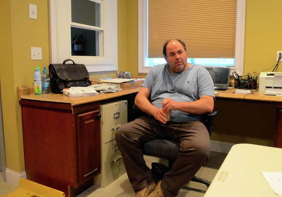 Bridgeport Board of Education member Chris Taylor sits his his office/kitchen in his residence on Davenport Street in Bridgeport, Conn., on Tuesday April 23, 2019. A complaint has been filed against Taylor accusing him of not living in Bridgeport. Photo: Christian Abraham, Hearst Connecticut Media / Connecticut Post