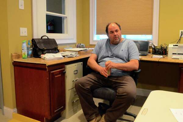 Bridgeport Board of Education member Chris Taylor sits his his office/kitchen in his residence on Davenport Street in Bridgeport, Conn., on Tuesday April 23, 2019. A complaint has been filed against Taylor accusing him of not living in Bridgeport.