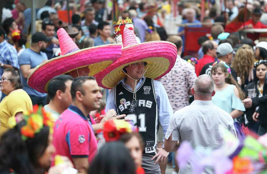 On March 13, the day the first travel-related COVID-19 case was reported in San Antonio, city officials postponed Fiesta, which was about a month from taking place. Photo: Tom Reel /Staff File Photo / 2019 SAN ANTONIO EXPRESS-NEWS