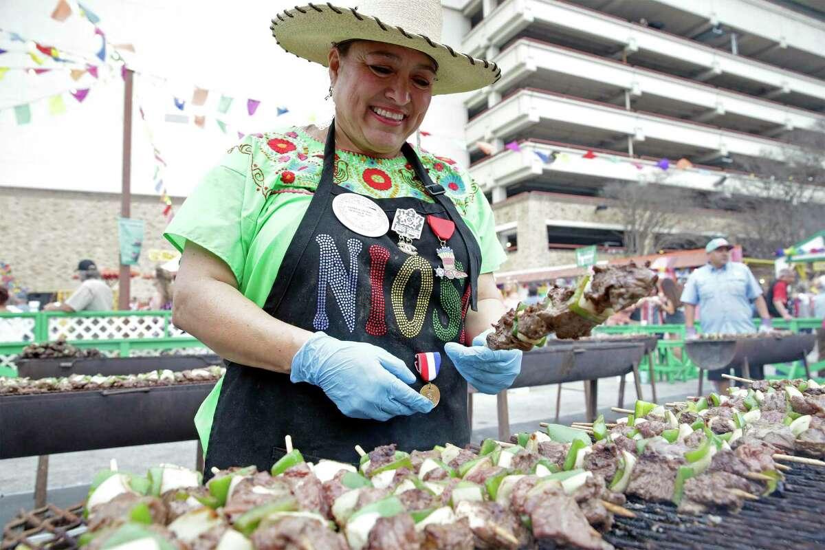 Patricia Salinas cooks up the Shish Kabobs at Bongo K Bobs during last year's NIOSA.