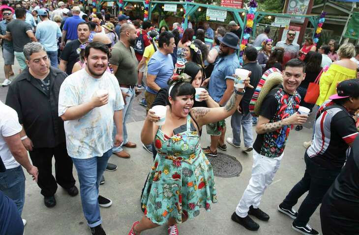 Sonja Moreno dances in the crowd holding beers during last year's NIOSA.