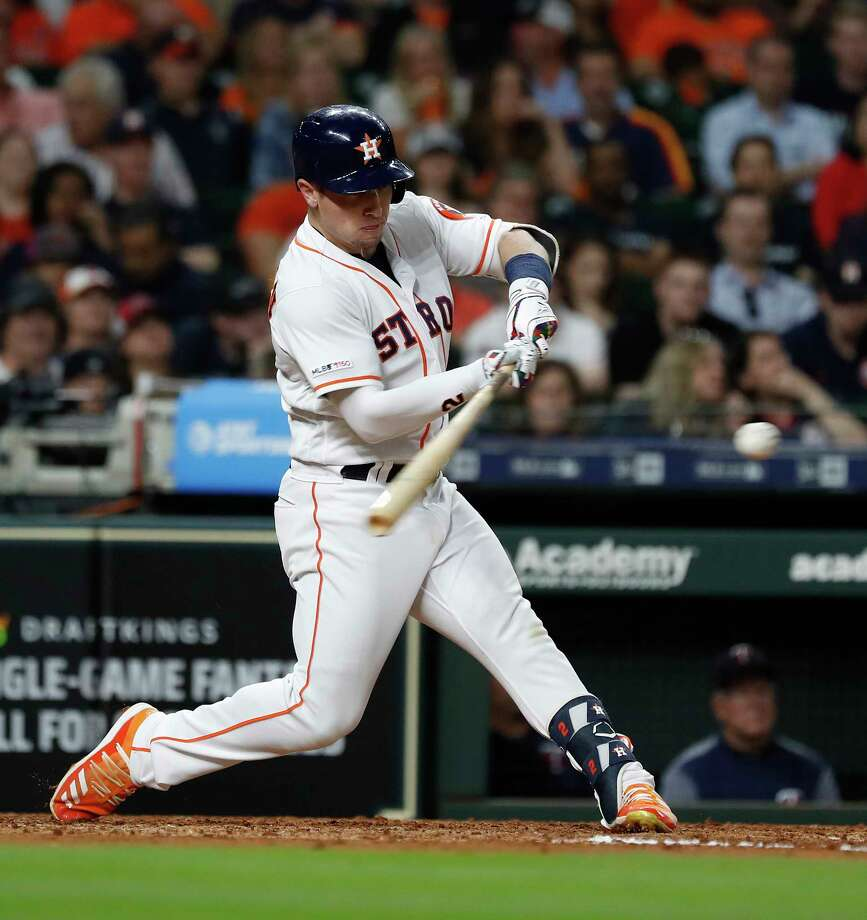 Houston Astros third baseman Alex Bregman (2) hits his RBI single during the fifth inning of an MLB baseball game at Minute Maid Park, Tuesday, April 23, 2019, in Houston. Photo: Karen Warren, Staff Photographer / © 2019 Houston Chronicle