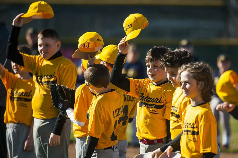 Fraternal Northwest Little League teams gather for an opening day ceremony on Tuesday, April 23, 2019 at the Sturgeon Road complex in Midland. (Katy Kildee/kkildee@mdn.net) Photo: (Katy Kildee/kkildee@mdn.net)