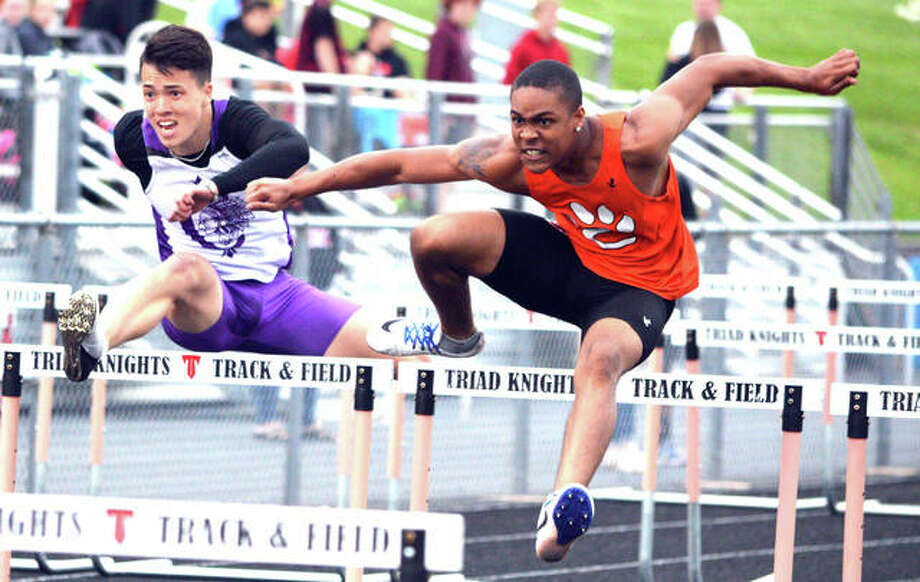 Xavier McKenney runs his way to a county championship in the 110-meter hurdles. Photo: Scott Marion/The Intelligencer