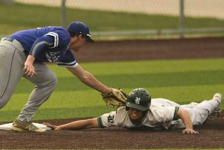 MacArthur third baseman Matt Murach tags out Reagan's Luke Hoggatt during the 27-6A baseball action at the NEISD Sports Park on Tuesday, April 23, 2019.