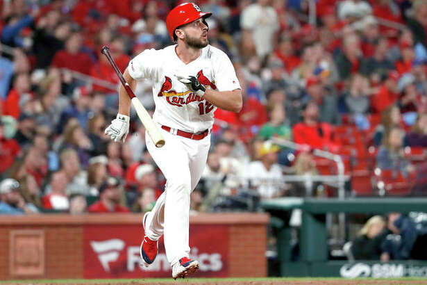 The Cardinals' Paul DeJong tosses his bat while watching his solo home run in the eighth inning of Tuesday night's game against the Milwaukee Brewers Tuesday in St. Louis.