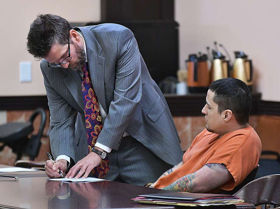 Ronald Anthony Burgos-Aviles, who is facing two capital murder charges in the slaying of Grizelda Hernandez, 27, and their 1-year-old son, Dominic Alexander Hernandez, confers with his defense attorney William Boggs in the 49th District Court on Tuesday. Photo: Cuate Santos /Laredo Morning Times / Laredo Morning Times