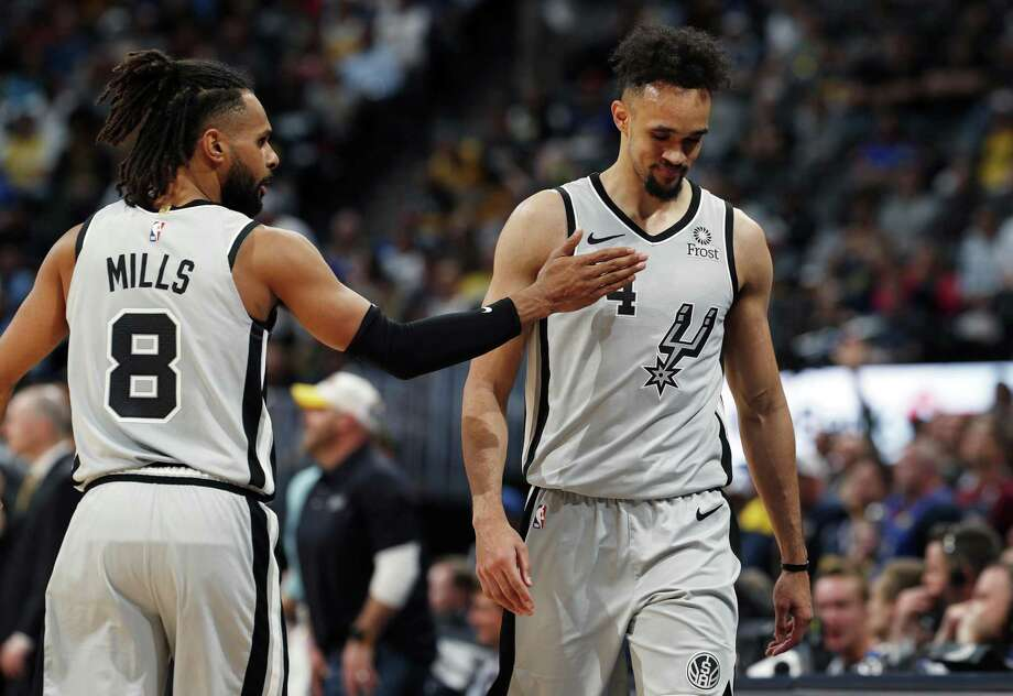 Patty Mills tries to encourage suddenly struggling point guard Derrick White, who finished with 12 points but got nine of those in fourth-quarter garbage time. Photo: Photos By David Zalubowski /Associated Press / Copyright 2019 The Associated Press. All rights reserved.
