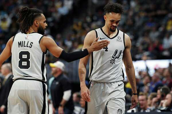 Patty Mills tries to encourage suddenly struggling point guard Derrick White, who finished with 12 points but got nine of those in fourth-quarter garbage time.