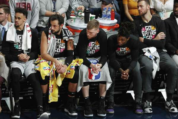 The Spurs' bench, which has contributed little in the series, looks on forlornly as the Nuggets pull away in the second half Tuesday night to take a 3-2 series lead.