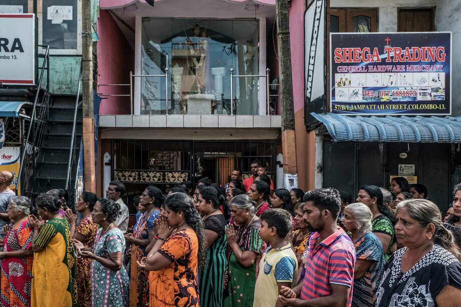 A group of residents pray outside St. Anthony's Church in Kochikade on April 23, 2019, in Colombo, Sri Lanka. St. Anthony's Church was attacked during a bomb blast on Easter Sunday. Photo: Photo For The Washington Post By Asanka Brendon Ratnayake / Asanka Brendon Ratnayake