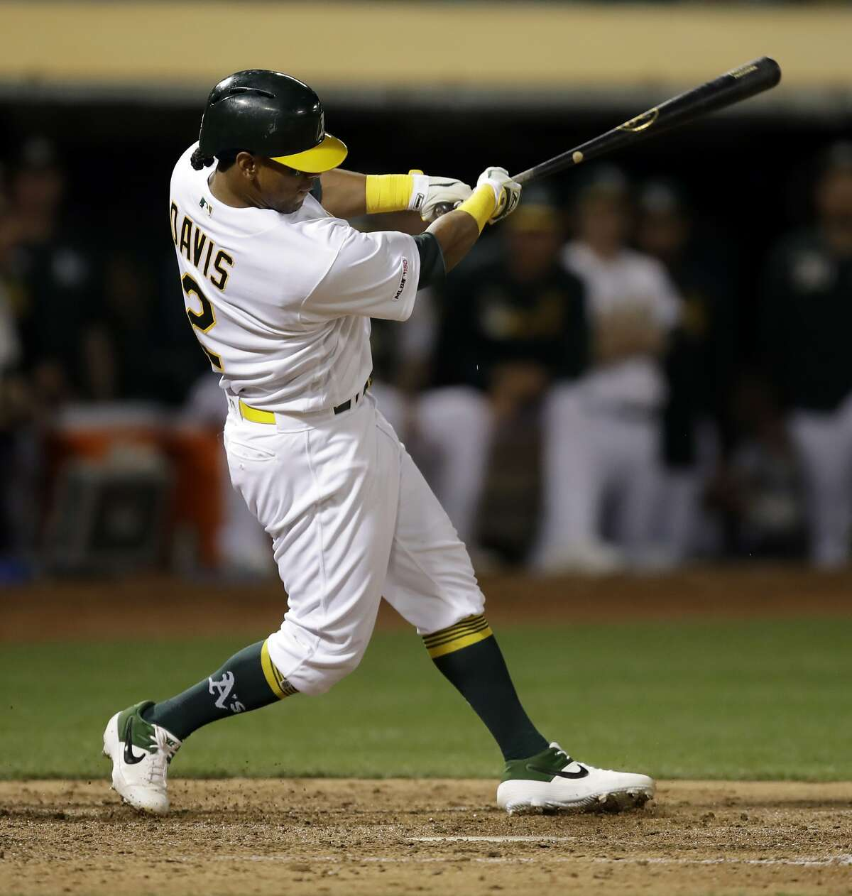 Oakland Athletics' Khris Davis swings for an RBI-single off Texas Rangers' Lance Lynn in the fourth inning of a baseball game Tuesday, April 23, 2019, in Oakland, Calif. (AP Photo/Ben Margot)