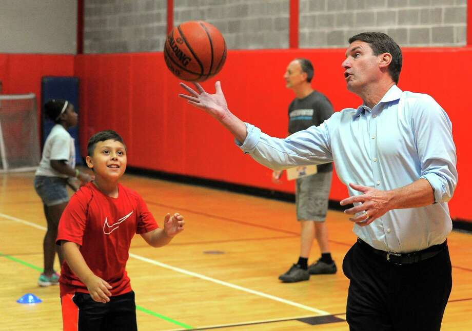 Tim Brown, former CEO of Nestle Waters North America, rebounds the basketball for campers participating in the Gold Medal Games at the Boys and Girls Club of Stamford on Aug. 4, 2016. Brown is among the Fairfield County Business Council directors who signed a letter to the General Assembly favoring highway tolls. Photo: Matthew Brown / Hearst Connecticut Media / Stamford Advocate