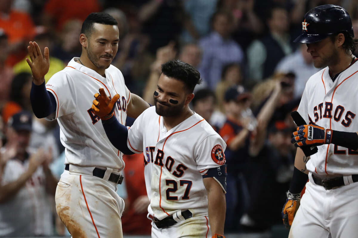 Astros second baseman Jose Altuve, being congratulated by teammates Carlos Correa, left, and Josh Reddick, says his homer binge this season is atypical for him.