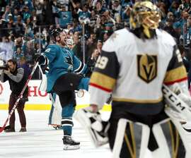 The Sharks' Tomas Hertl (left) celebrates as Knights goalie Marc-Andre Fleury skates away after a 5-4 overtime win in Game 7 that catapulted San Jose into the second round of the playoffs.