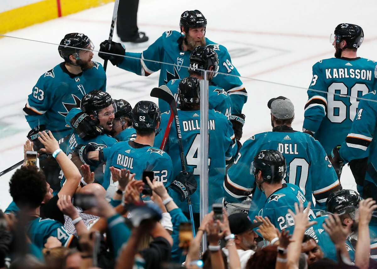 San Jose Sharks celebrate win against the Vegas Golden Knights during the overtime period of Game 7 of an NHL hockey first-round playoff series Tuesday, April 23, 2019, in San Jose, Calif.