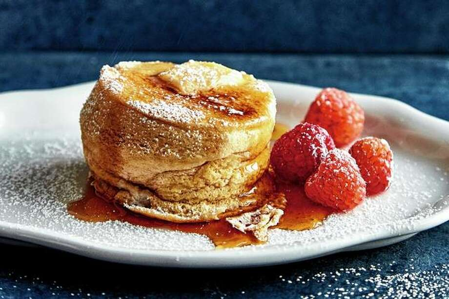 Japanese soufflé pancakes attain their distinctive height after being cooked at a low temperature for a relatively long time. Photo: Romulo Yanes | The New York Times