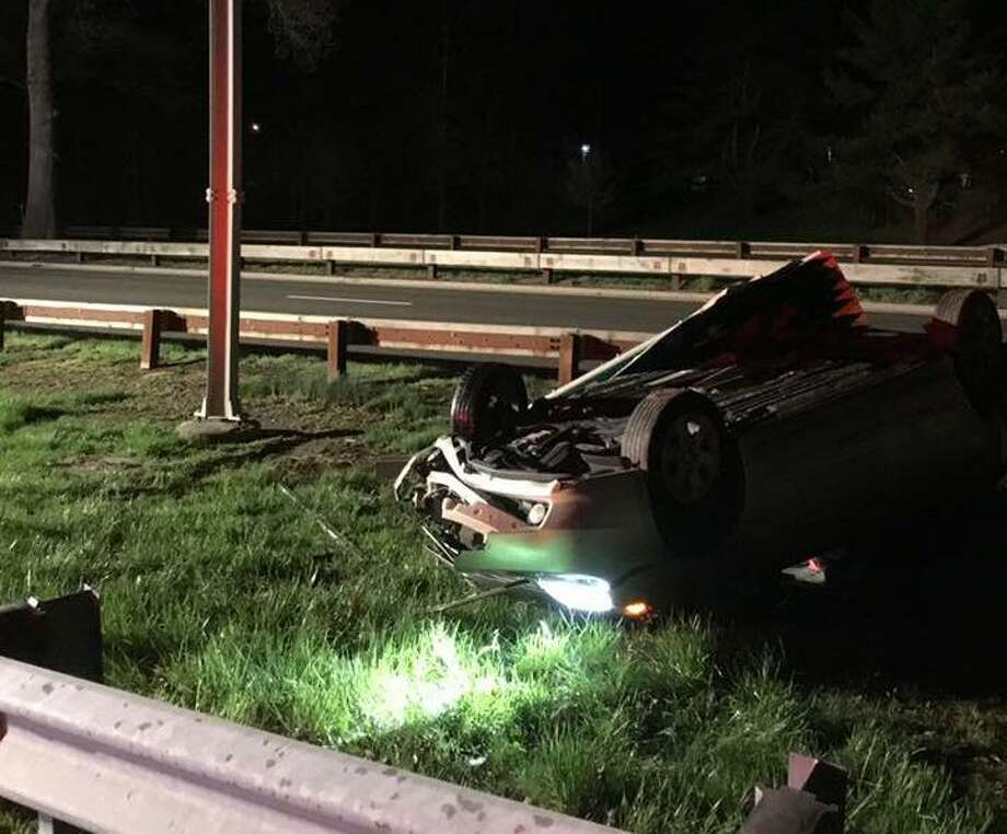 A car struck a guardrail and rolled over on Route 25 on Tuesday, April 23, 2019 in Trumbull. When Trumbull Volunteer Fire Company firefighters arrived they found all the occupants were out of the vehicle. Photo: Trumbull Volunteer Fire Co. Photo