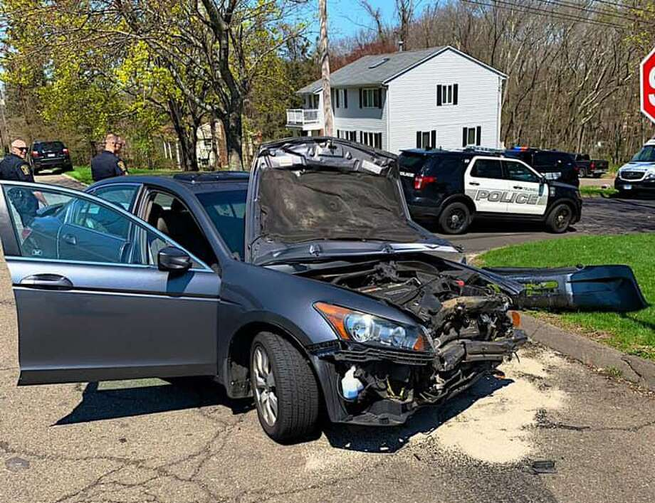 A two-vehicle crash on Merrimac Drive on Tuesday, April 23, 2019 left at least two people injured. The crash happened shortly after 1 p.m. with both the Long Hill and Trumbull Center fire departments responded. Photo: Long Hill Volunteer Fire Co. Photo